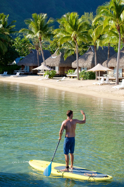 https://tahititourisme.com/wp-content/uploads/2019/01/Paddle-boarding-in-the-lagoon-at-Manava-Beach-Resort-Spa-Moorea-1.jpg