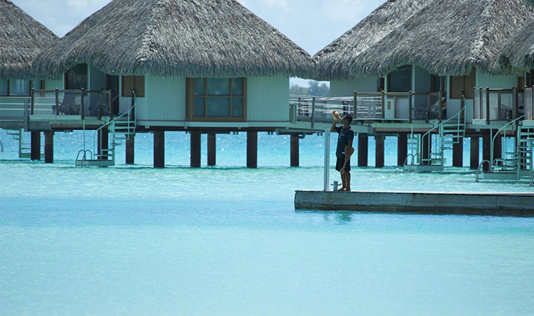 white sand beaches and blue water from bora bora bungalow
