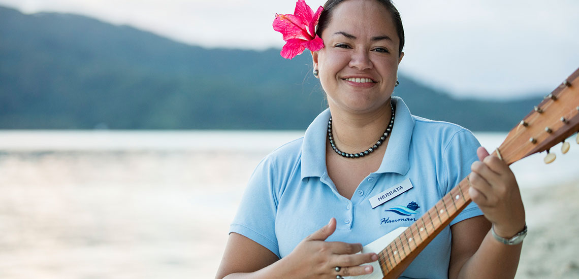 local tahitian woman playing uke