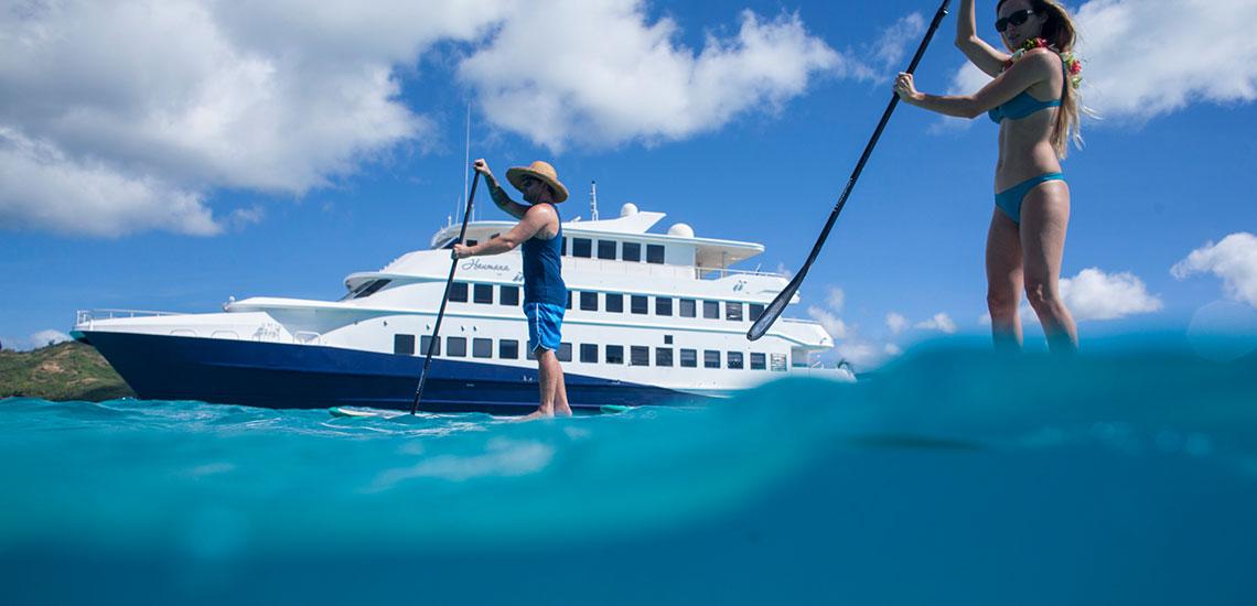 paddle boarding next to cruise ship